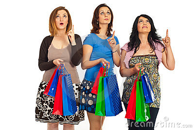 Amazed shoppers women looking up