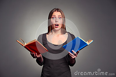 Amazed woman with books