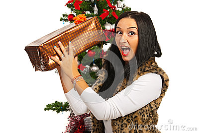 Amazed woman with Christmas present