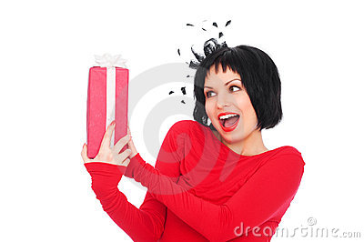 Amazed woman with gift box
