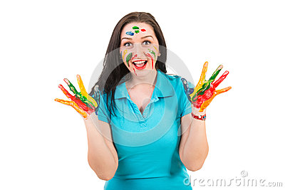 Amazed woman with hands in paints
