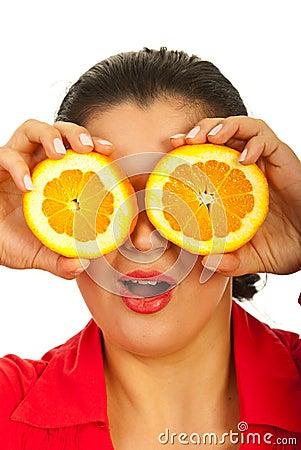 Amazed woman holding orange slices