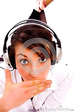 Amazed woman listening to music