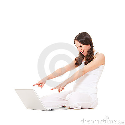 Amazed woman looking at laptop