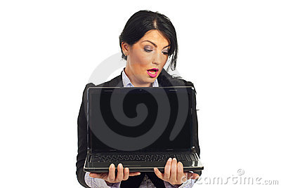 Amazed woman looking to blank laptop  screen