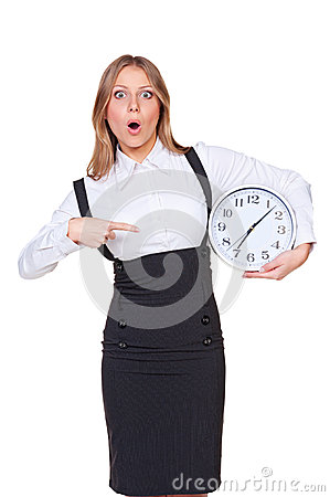 Amazed woman pointing at the clock