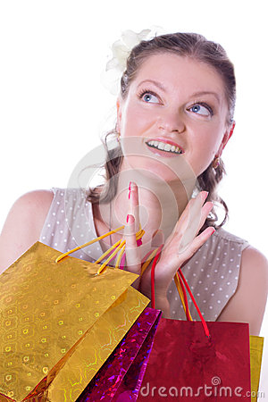 Amazed woman with shopping bags
