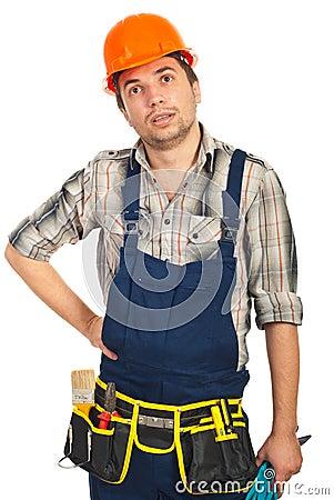 Amazed workman looking up