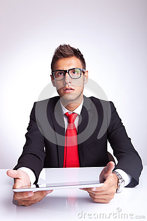 Amazed young business man with pad