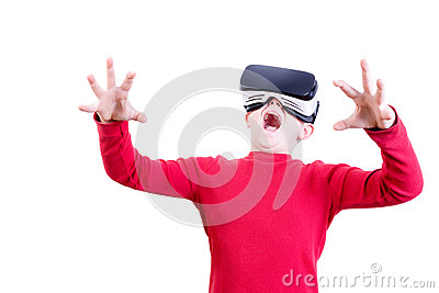 Amazed young child in virtual reality headset Stock Photo