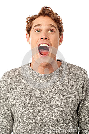 Amazed young guy with open mouth
