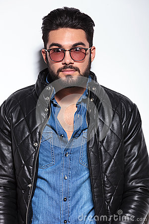 Amazed young man in leather jacket