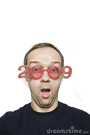 Amazed young man wearing funny glasses