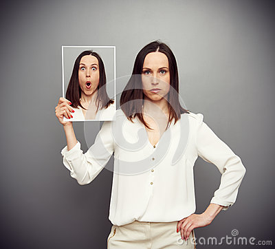 Amazed young woman hiding her emotions