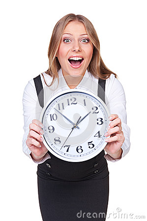 Amazed young woman showing the clock