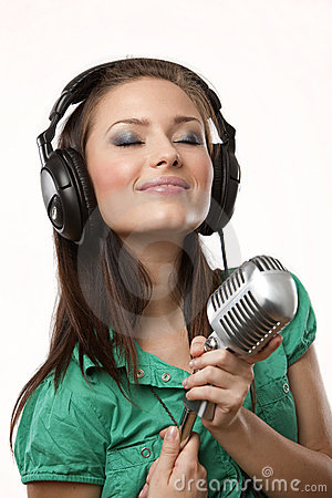 Amazing beautiful girl with studio microphone