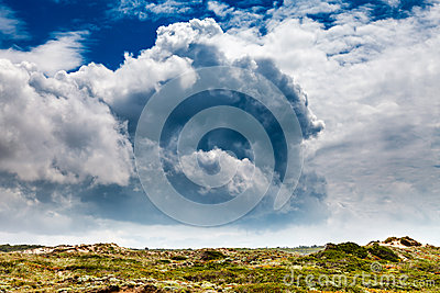 Amazing Clouds above Green Meadow in Guincho Beach