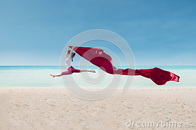 Amazing dance with red flag at beach