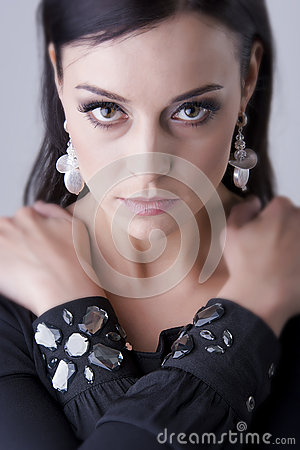 Amazing eyes woman with arms crossed, close up portrait