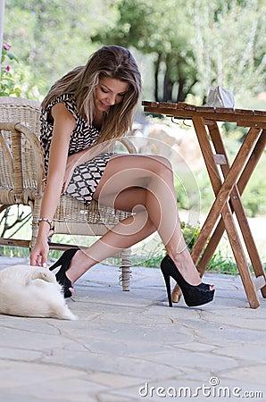 http://thumbs.dreamstime.com/x/amazing-leggy-women-dog-companionship-cute-slim-woman-sitting-wooden-chair-wearing-high-heels-short-dress-60486142.jpg