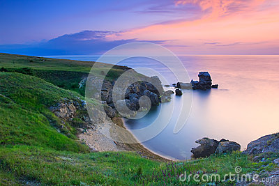 Amazing rocky coastline at sunset
