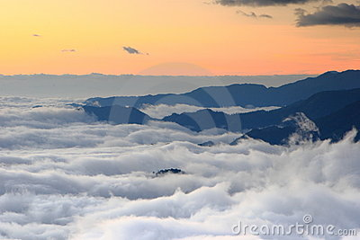 Amazing sea of clouds with sunset