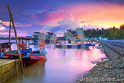 Amazing sunset at the harbor in Thailand