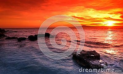 Amazing sunset over rocky seascape