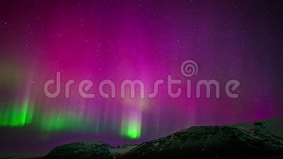 Amazing time lapse 4k view on purple green bright colorful northern light aurora borealis australis glow in night sky. Amazing time lapse view on purple green stock video