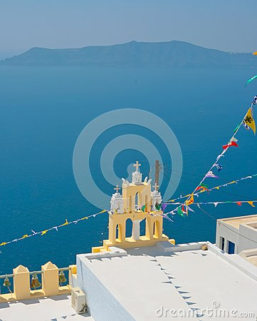 Amazing view of yellow chapel in Oia, Santorini