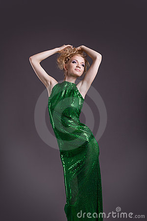 Amazing woman posing in transparent green costume