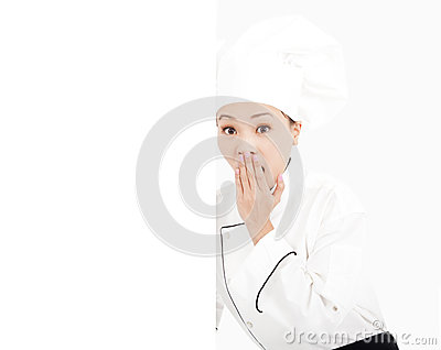 Amazing young woman chef looking with blank board