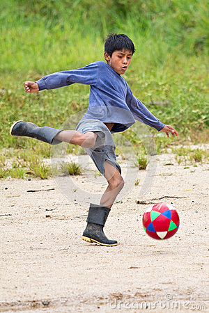 Amazonian Quechua boy playing soccer Editorial Photo