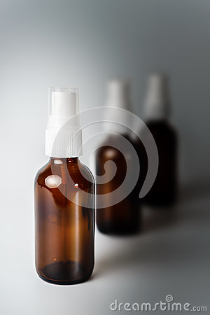 Free Amber Brown Glass Spray Bottles Fading To Grey Royalty Free Stock Photo - 62565475