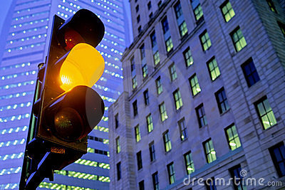 Amber traffic light in city