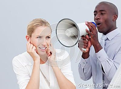 Ambitious businessman shouting through a megaphone