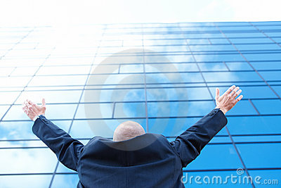 Ambitious Businessman standing and looking upwards