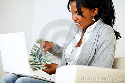 Ambitious excited woman with dollars