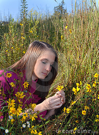 Amble in Field of Yellow Flowers