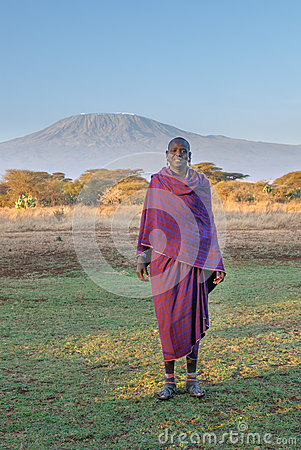 AMBOSELI, KENYA - September, 20: Young Masai man and Kilimanjaro Editorial Image