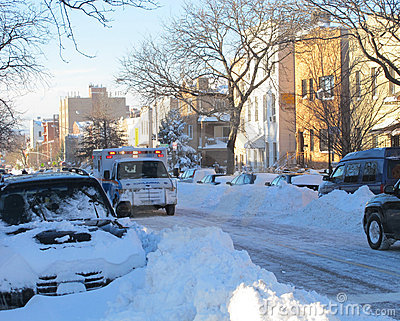 Ambulance on the street after blizzard Editorial Stock Image