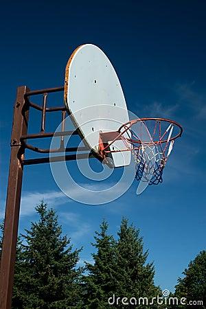 American Basketball Hoop against Blue Sky