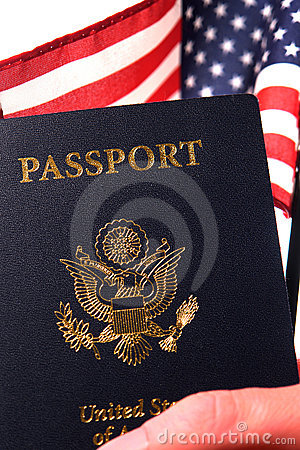 American Citizenship Passport and US Flag in Hand