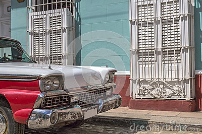American classic car in front of a colonial house in Trinidad, Cuba