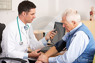 American doctor taking senior man s blood pressure