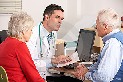 American doctor talking to senior couple