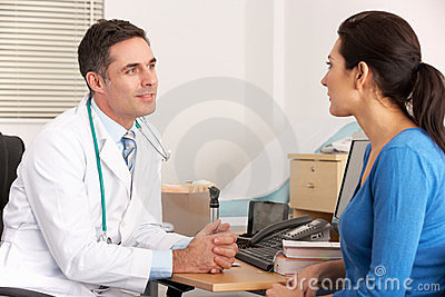 American doctor talking to woman in surgery