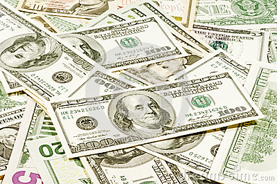 American dollar bills scattered in a chaotic