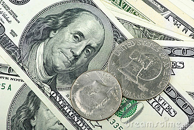 American dollars: bills and coins close-up