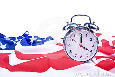 American flag and alarm clock isolated on white
